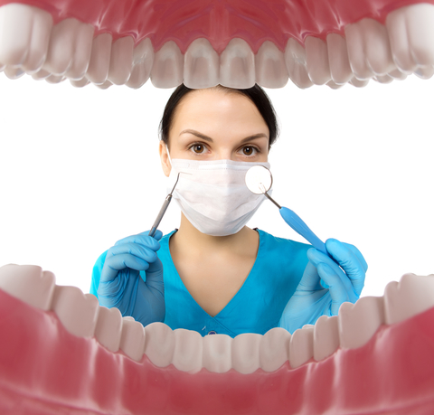 Fayetteville NC Dentist Examining Patient's Mouth
